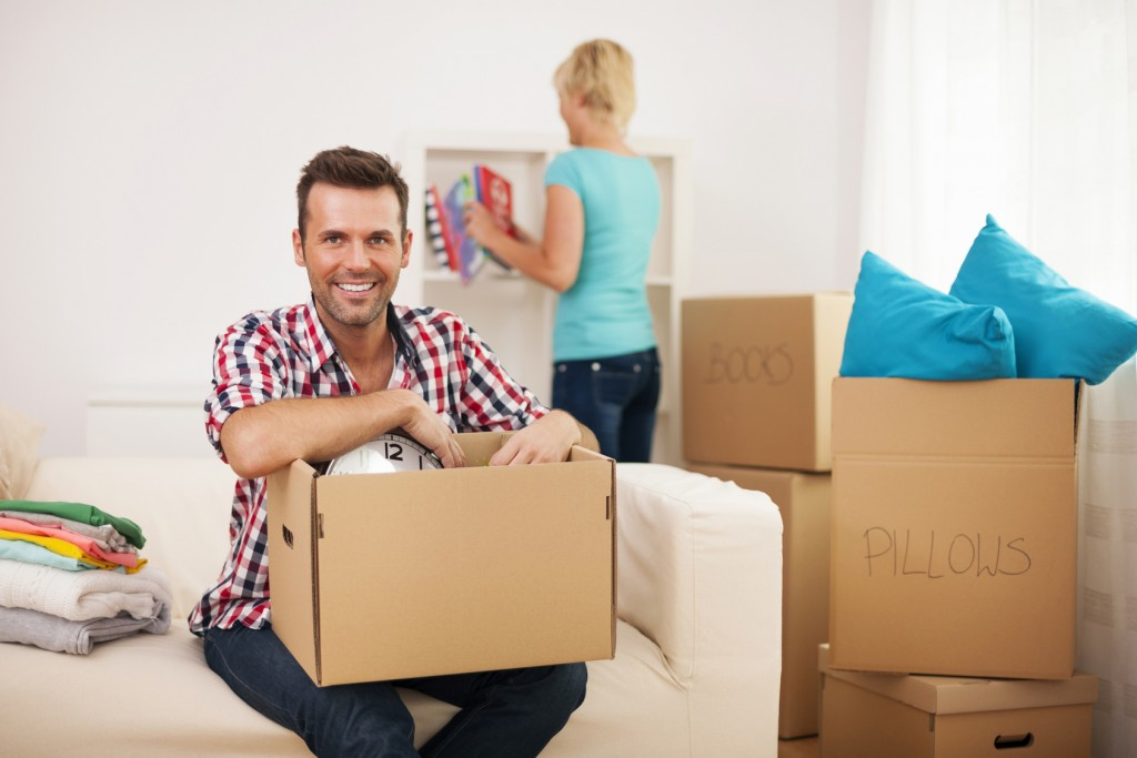 Young couple unpacking in their new home